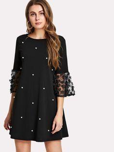 vestido negro corto bordado suelto